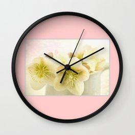 Hellebores in blue jug Wall Clock