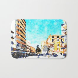 People on the street under the buildings of Agropoli Bath Mat