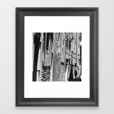 Into the shadows b&w Framed Art Print