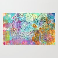ohm Area & Throw Rugs featuring find your inner power flower mandala by SannArt