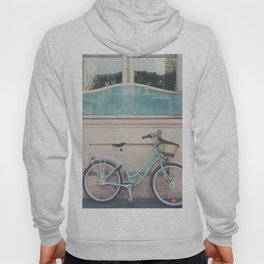 a mint green bicycle on the streets of Paris. Hoody