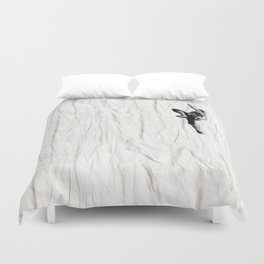 Woman Climbing a Wrinkle Duvet Cover