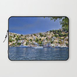 Symi island in Greece. Traditional houses. Sunny day with blue sky and sea. Laptop Sleeve
