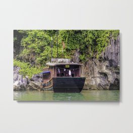 Traditional House Boat with a Clothesline on the back Parked in front of One of Limestone Mountains in Halong Bay, Vietnam Metal Print