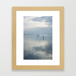 A blue lagoon and the water reflections Framed Art Print