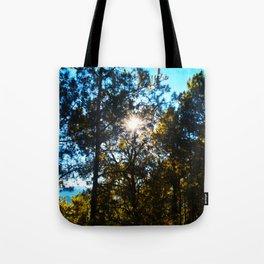 Sun Peeking Through Trees Tote Bag
