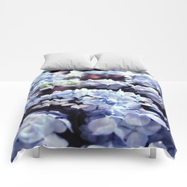 blue flowers floating Comforters