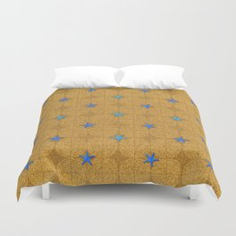Blue starfish on a golden sandy beach Duvet Cover