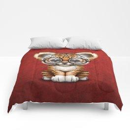 Cute Baby Tiger Cub Wearing Eye Glasses on Deep Red Comforters