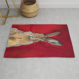 Cottontail Rabbit On Red Rug