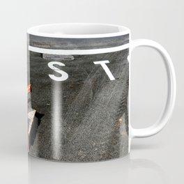 Stop and warning signs on black asphalt road Coffee Mug