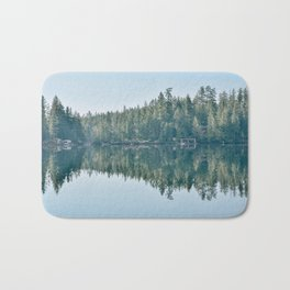 Forest reflection on a lake Bath Mat