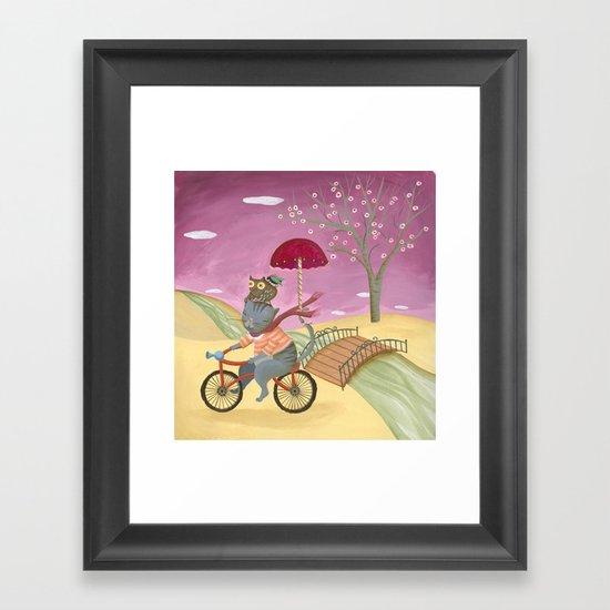 Riding the bike. Framed Art Print