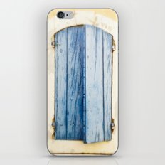 Blue wooden shutter in yellow wall. iPhone & iPod Skin