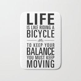Life is like riding a bicycle. White Background. Bath Mat