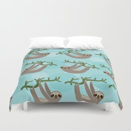 Three-toed sloth on green branch blue background Duvet Cover