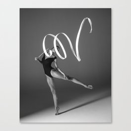 Young gymnast woman stretching and training Canvas Print