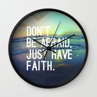 pocketfuel Wall Clocks featuring JUST HAVE FAITH by Pocket Fuel