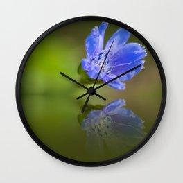 Blue wildflower reflection Wall Clock