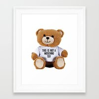 moschino Framed Art Prints featuring TEDDY BEAR PARFUM MOSCHINO by Claudio Velázquez