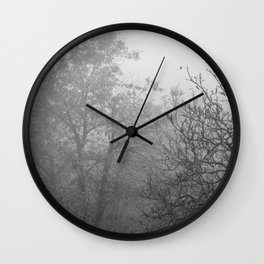 Black and white autumnal naked trees surrounded by fog Wall Clock