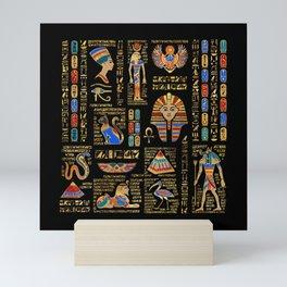 Egyptian hieroglyphs and deities on black Mini Art Print
