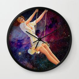 Swinging in Space Wall Clock