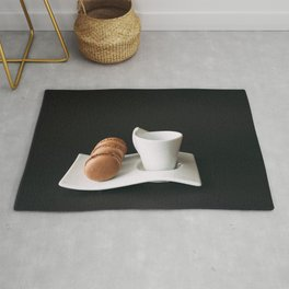 Set of cup of coffee and macaroons against black background Rug
