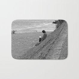 Woman Reading on Hill in France - Black and White Bath Mat
