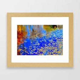 Golden leaves, shimmering pond Framed Art Print