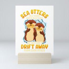 Cute & Funny Sea Otters Hold Hands When Sleeping Mini Art Print
