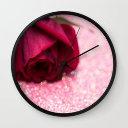 Rose over pink abstract background with bokeh defocused lights Wall Clock