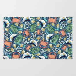 Cap and crab with seashells on water drops Rug