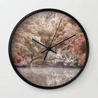 frozen Wall Clocks featuring Frozen by Françoise Reina