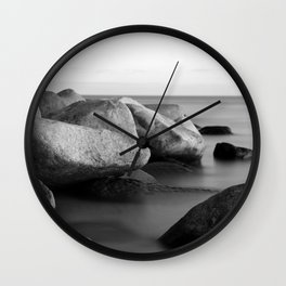 Stones in the sea Wall Clock