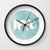 pocketfuel Wall Clocks featuring HOPE by Pocket Fuel