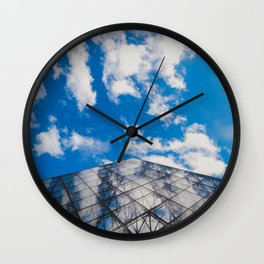 Cloud reflection in the Louvre Pyramid Wall Clock