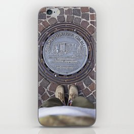 Man standing in front of a manhole iPhone Skin