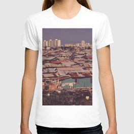 'MODERN BUILDINGS TOWER OVER THE SHANTIES CROWDED ALONG THE MARTIN PENA CANAL' T-shirt