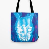 donnie darko Tote Bags featuring Darko by Logan David