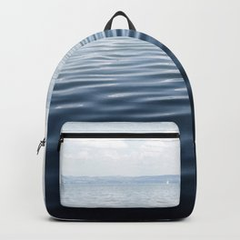 calm blue water Backpack