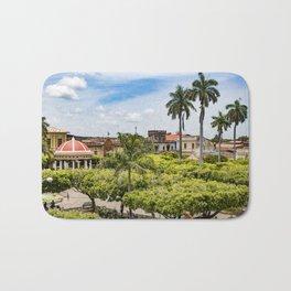 Red Gazebo and Trees Lining the Parque Colon de Granada in Nicaragua Bath Mat