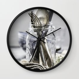 Forks spoons and knifes in a glass jar on grey vintage background Wall Clock
