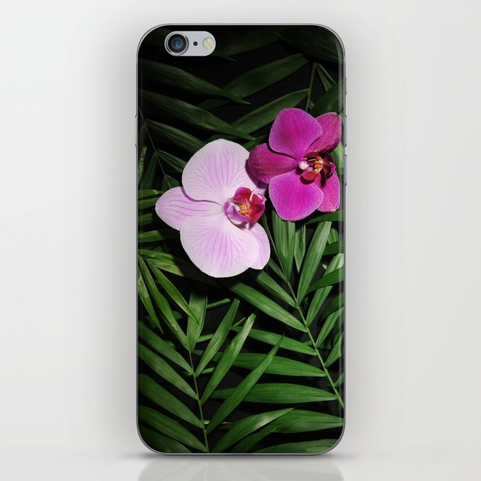 Orchids with palm leaves iPhone Skin