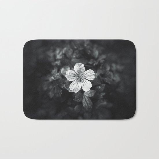 Minimalistic black and white flower petal Bath Mat