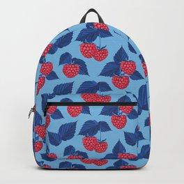 Raspberry on blue background Backpack