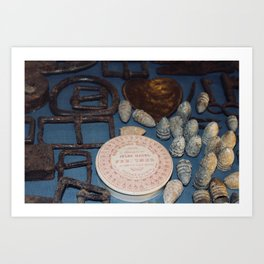 Belt buckles, iron musket bullets and perfume Art Print