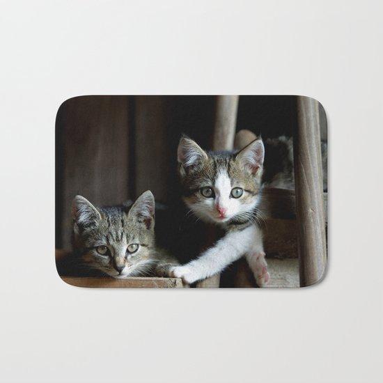 A small cats dream team in the siesta Bath Mat