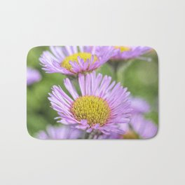 Aster pink daisy flowers in soft focus Bath Mat