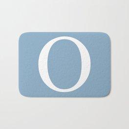 Letter O sign on placid blue background Bath Mat